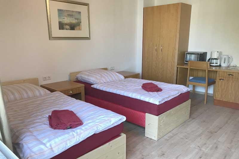 Betten im Doppelzimmer des Boardinghouses